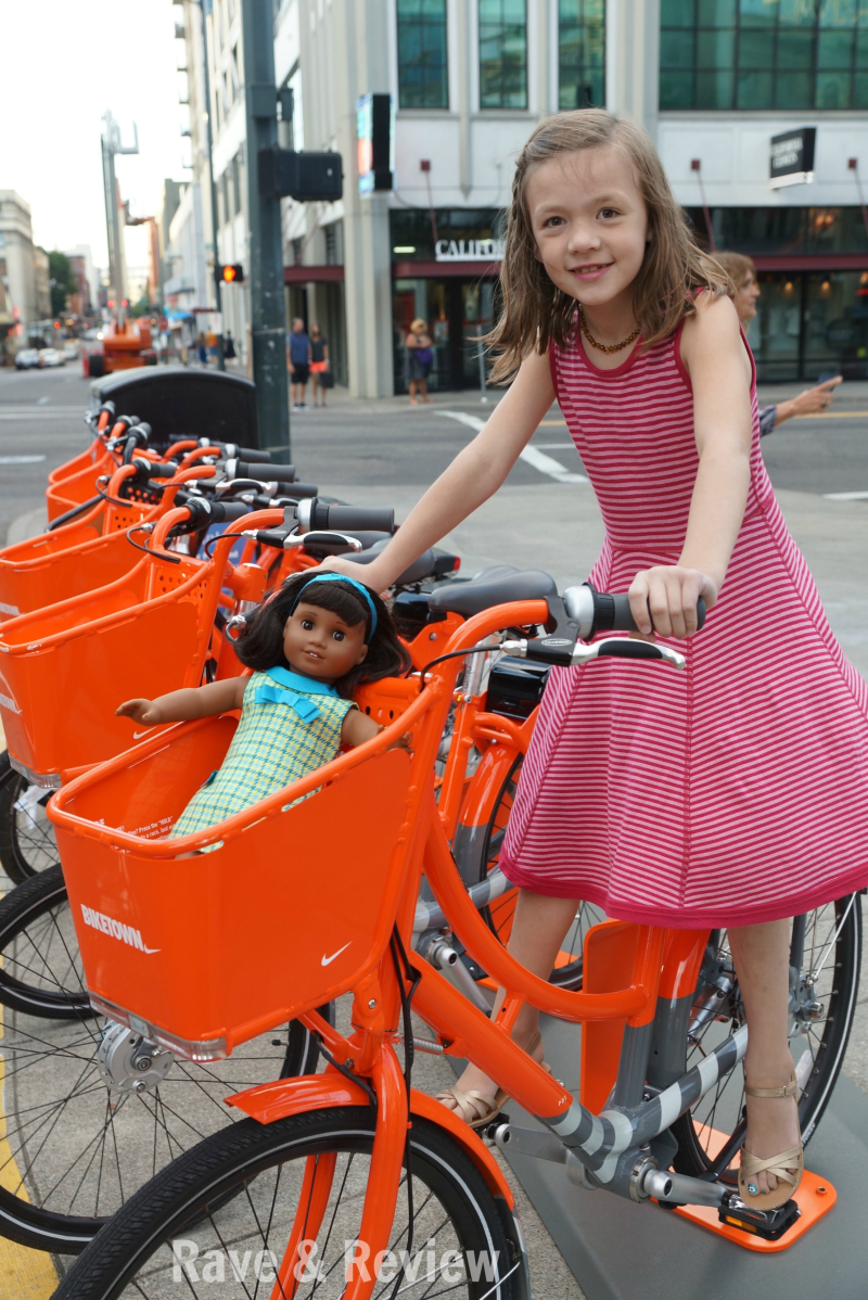 American Girl Melody on bike